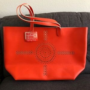 NWT laser cut tote bag